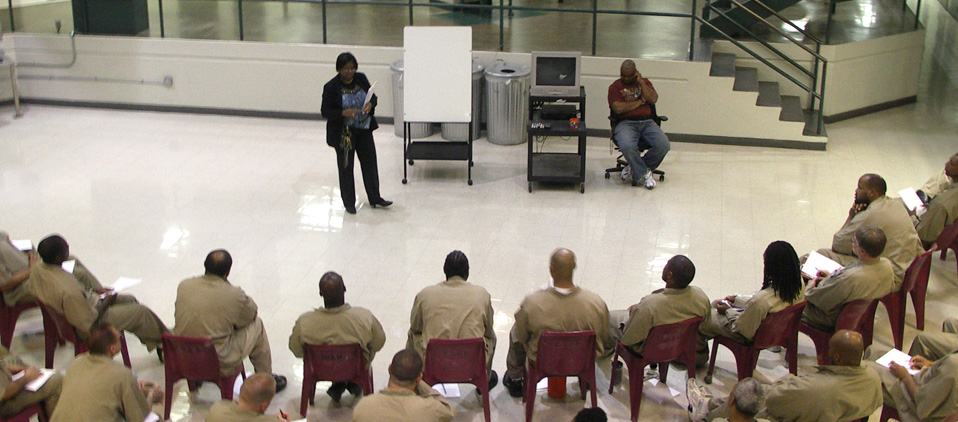Federal inmates are receiving instruction from BOP staff while attending a BOP program